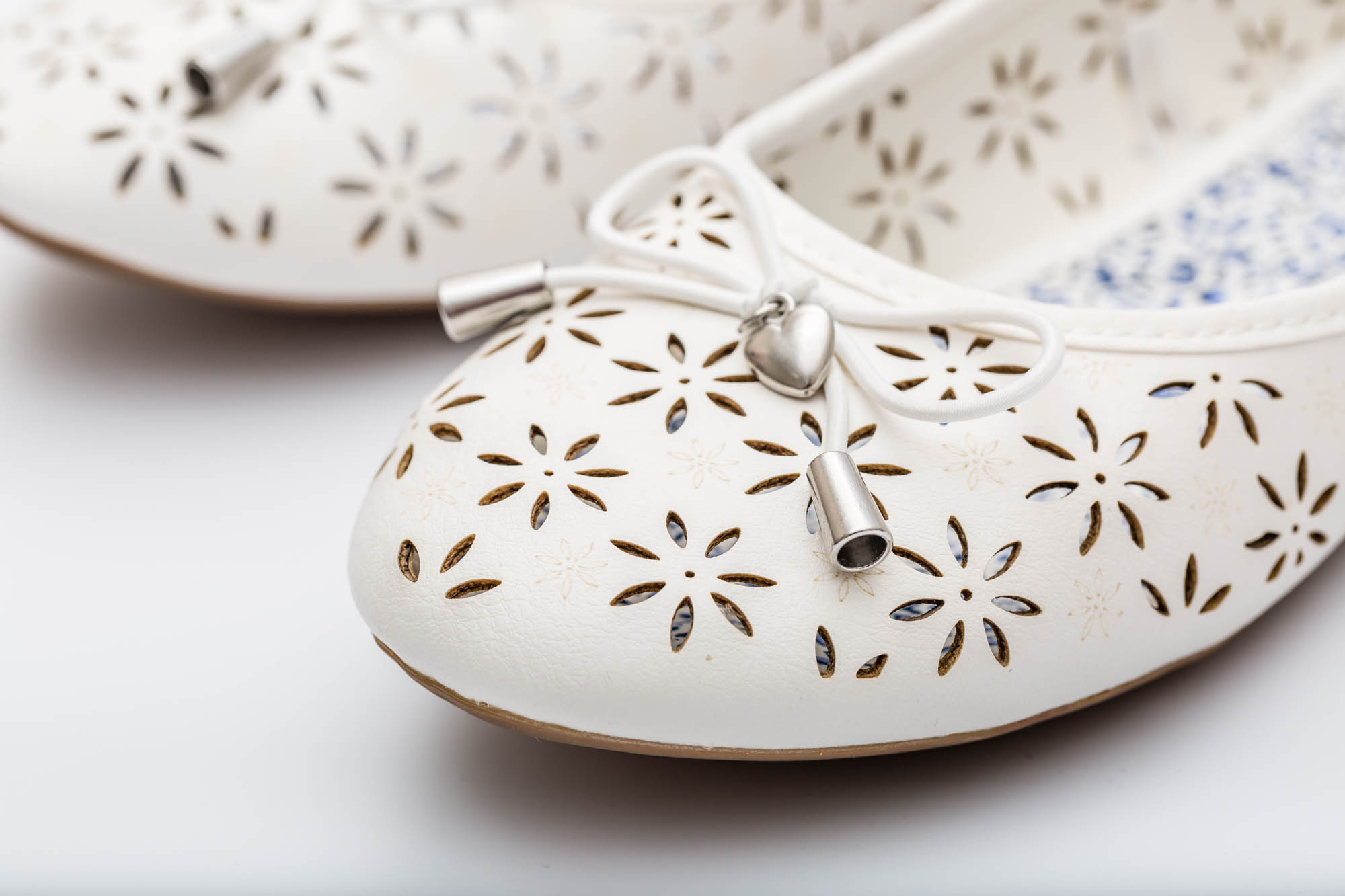 Laser-cut detail on leather shoes