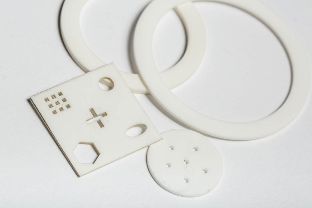 Pieces of laser-cut alumina ceramic