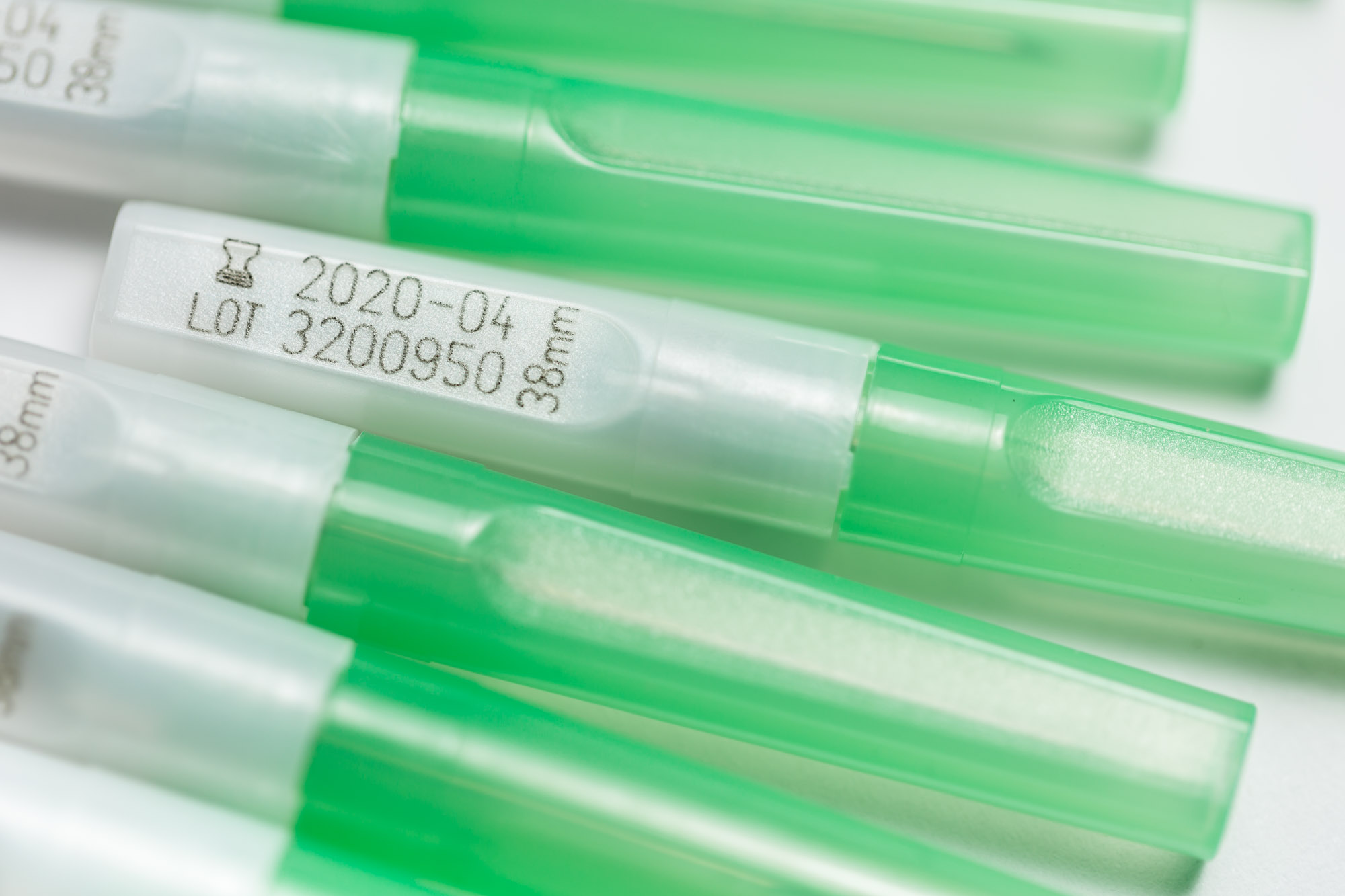 Laser marked plastic syringe covers