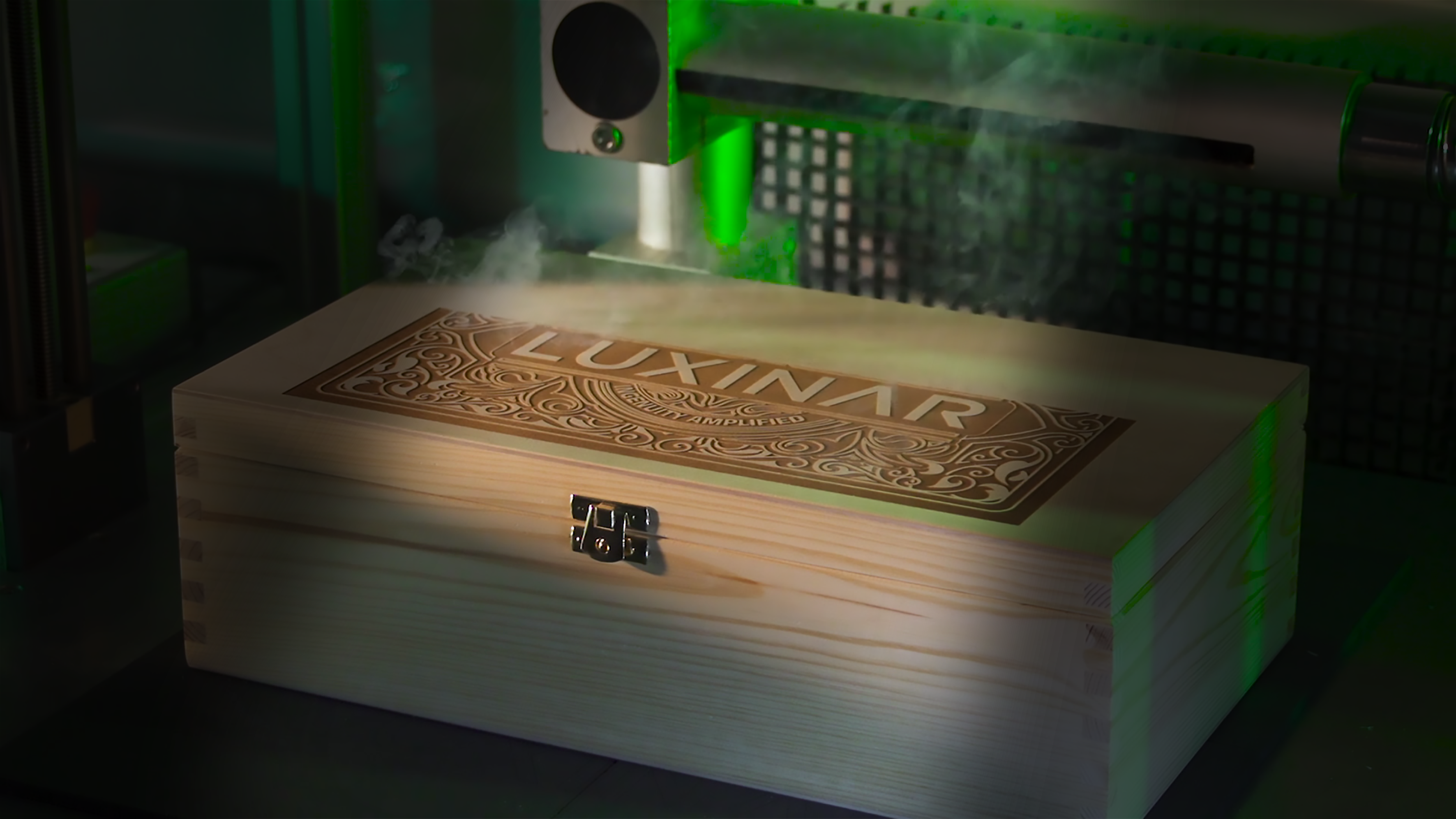 CO2 laser marking wooden box with Luxinar logoCO2 laser marking wooden box with Luxinar logo